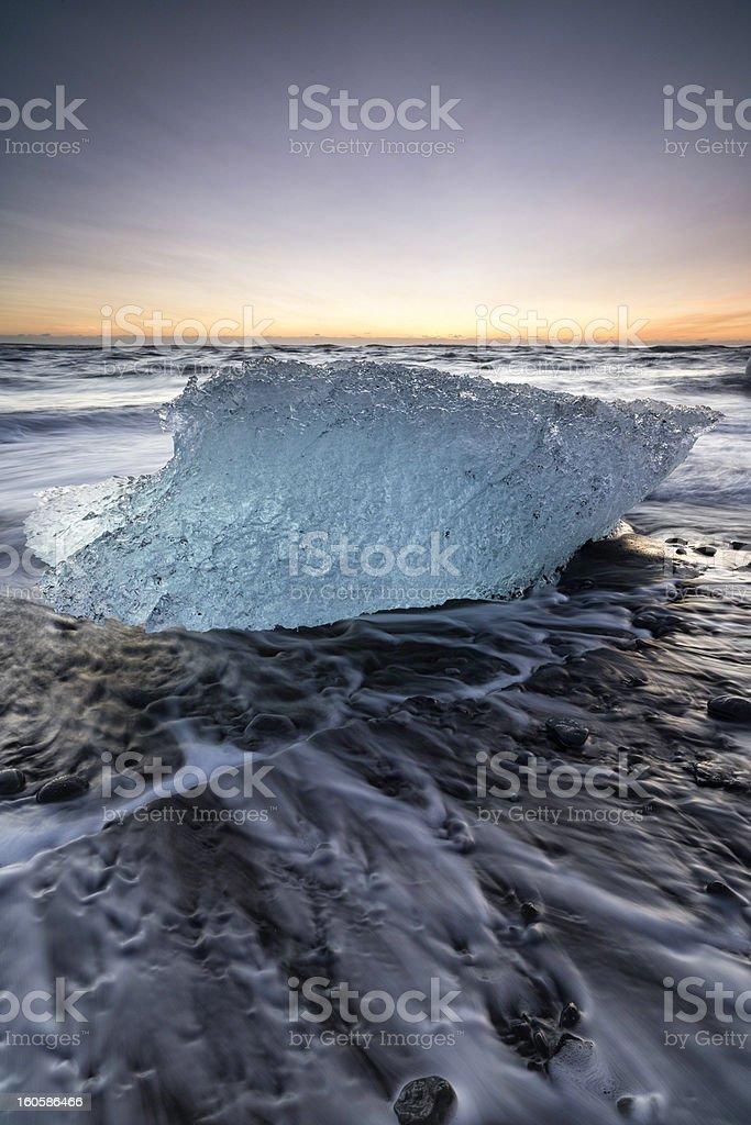 Iceberg on beach at sunrise, Jokulsarlon, Iceland stock photo