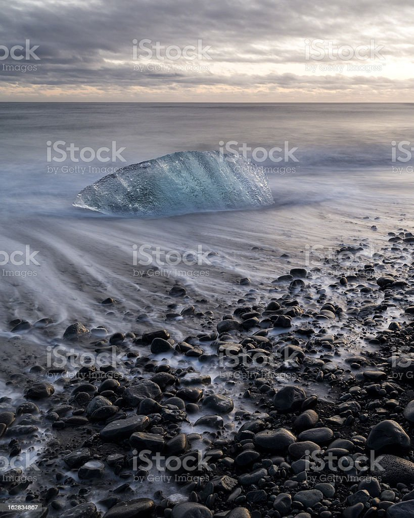 Iceberg on beach at sunset, Jokulsarlon, Iceland stock photo