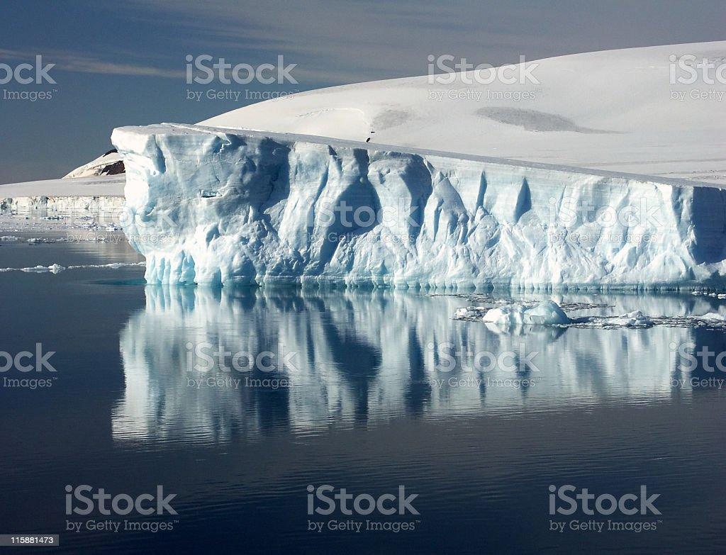 Iceberg reflection in The Antarctic Peninsula royalty-free stock photo