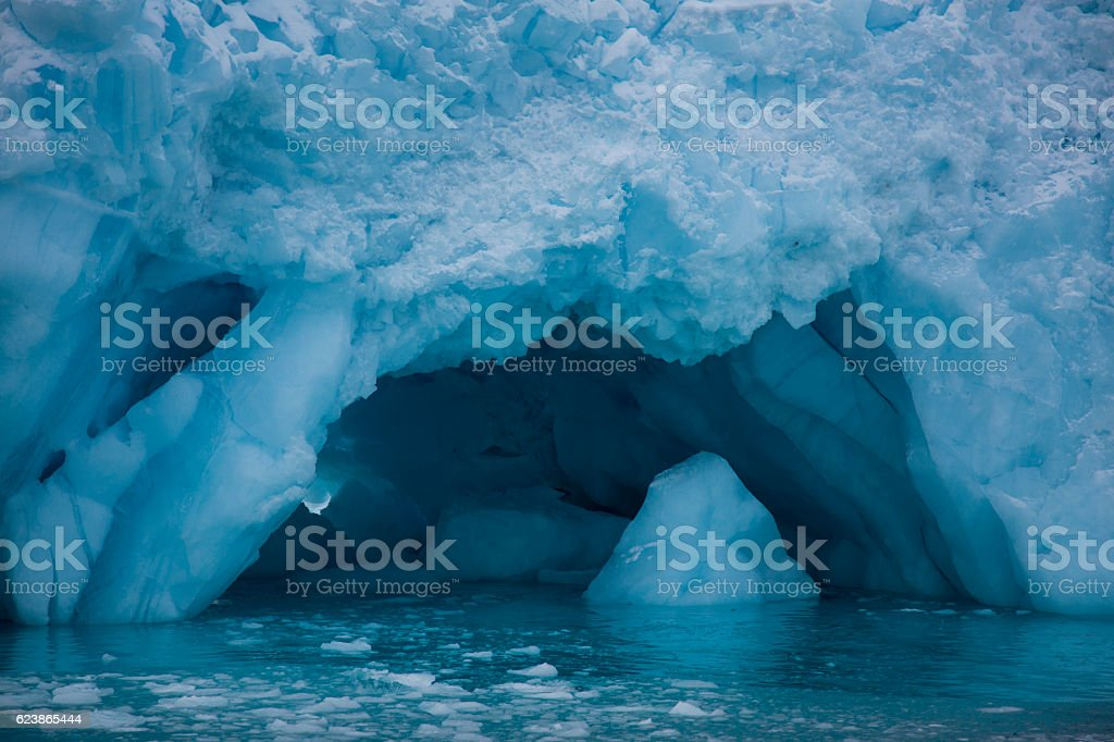 iceberg with cave stock photo