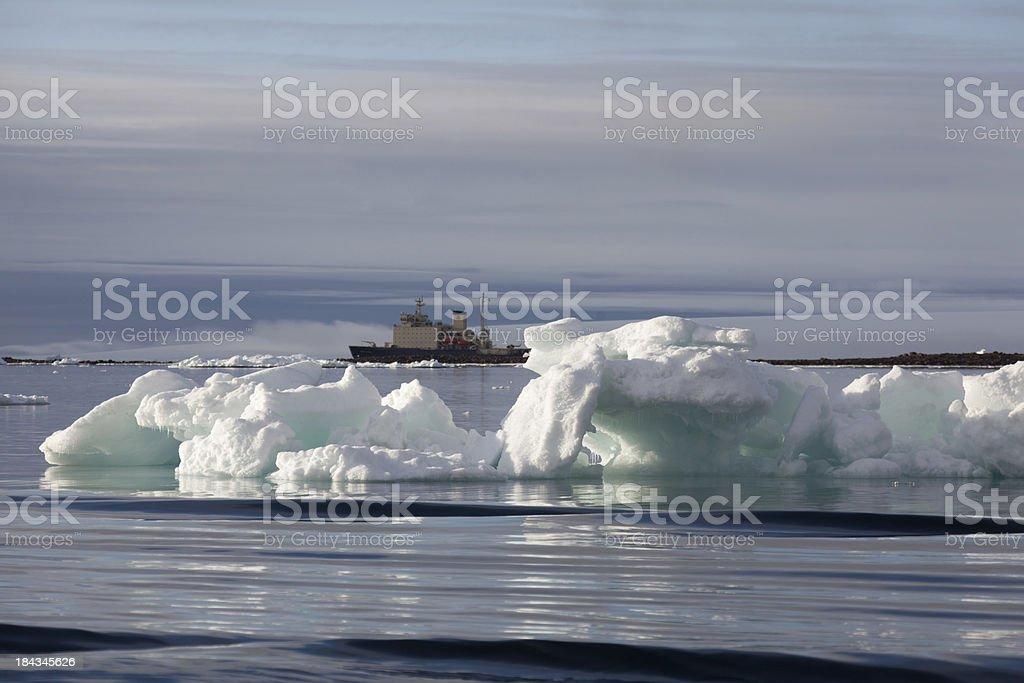 Iceberg with icebreaker in the background arctic ocean stock photo