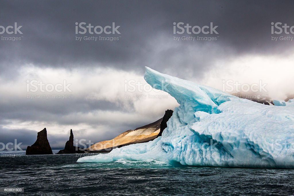 Iceberg with reflection drifting in the arctic ozean stock photo