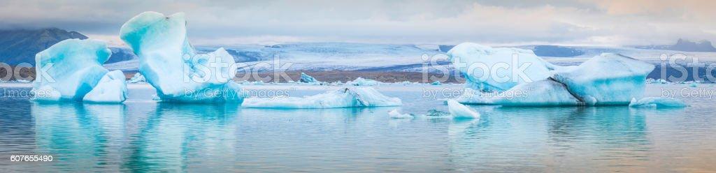 Icebergs floating in Arctic ocean lagoon below glaciers panorama Iceland stock photo