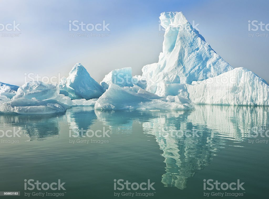 Icebergs Floating in Calm Water stock photo
