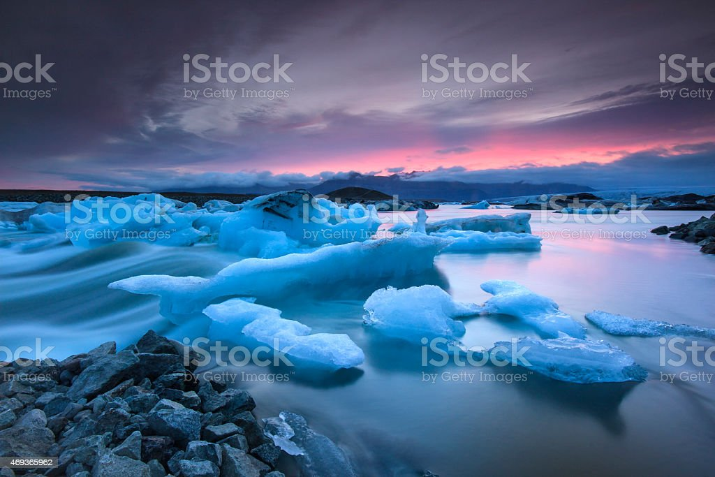 Icebergs floating in Jokulsarlon glacier lake at sunset stock photo