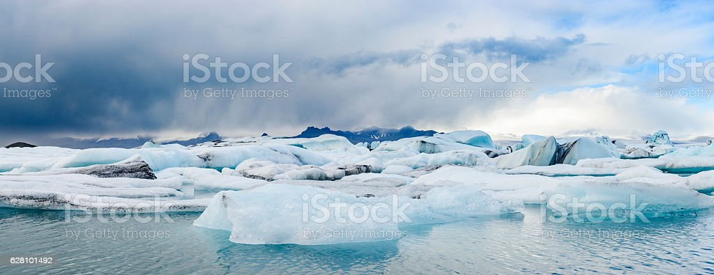 Icebergs floating  in the Jokulsalon glacier lagoon in Iceland. stock photo