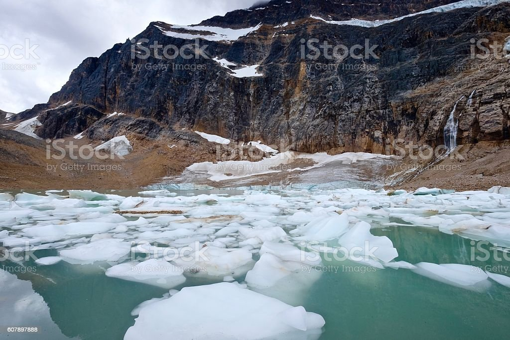 Icebergs in moraine lake and mountains. stock photo
