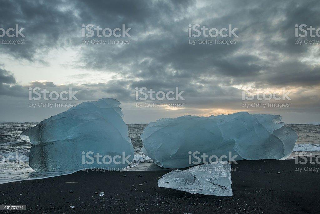 Icebergs on a black sand beack at Jokulsarlon, Iceland royalty-free stock photo