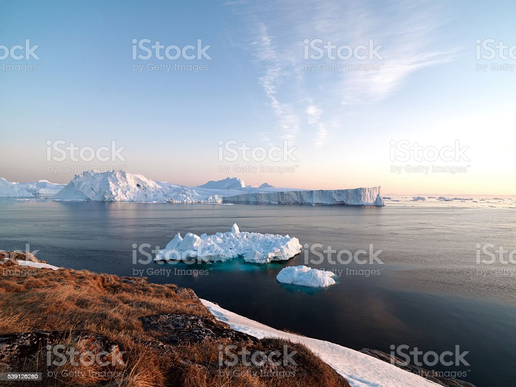 Icebergs on arctic ocean in Ilulissat icefjord, Greenland stock photo