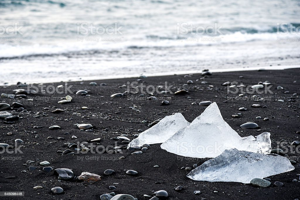 Icebergs on black volcanic beach, Iceland stock photo
