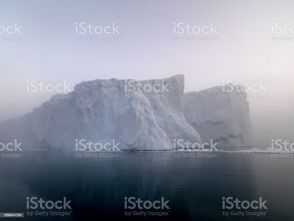 icebergs under the fog stock photo