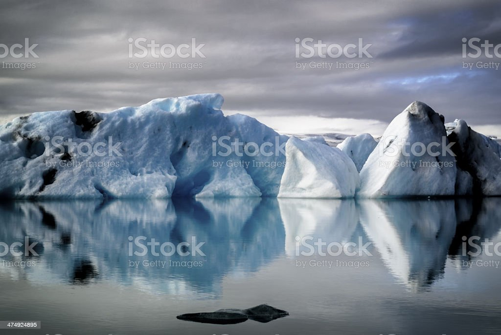 Icebergs with a moody sky in Iceland stock photo