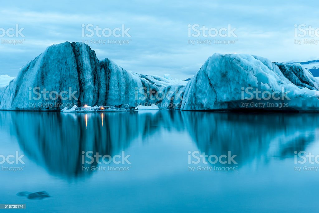 Icebergs with candles, Jokulsarlon ice lagoon, annual firework show, Iceland stock photo