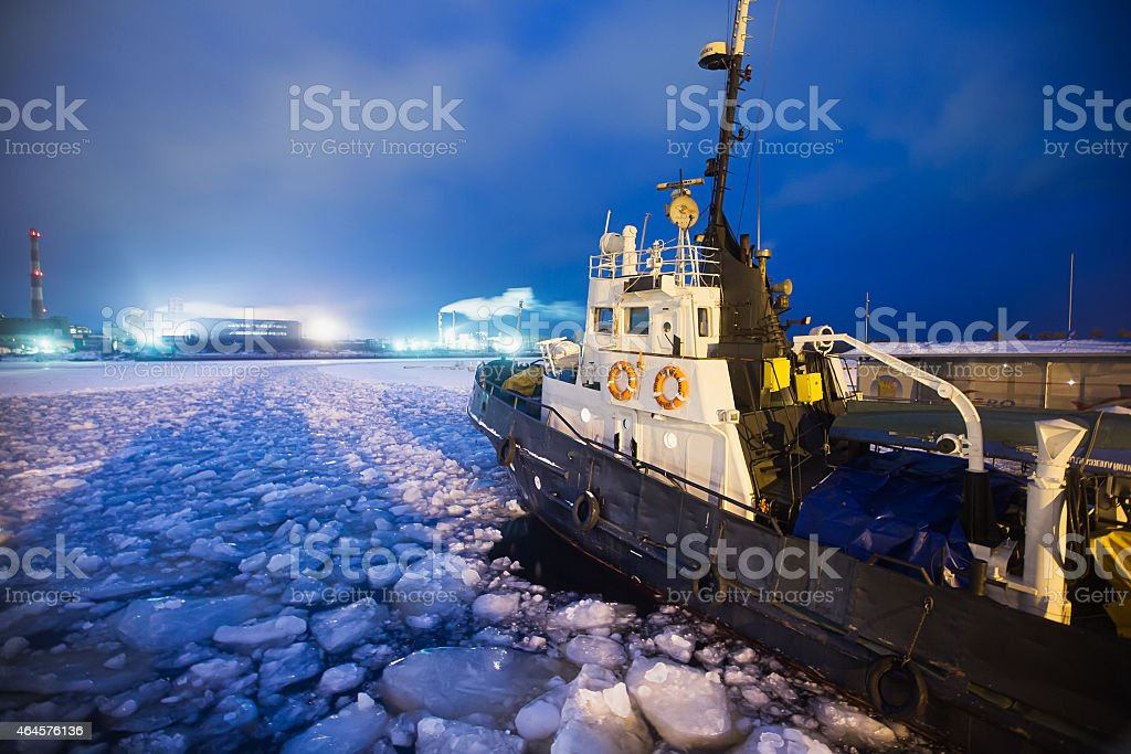 Icebreaker ship trapped in ice tries to leave the bay stock photo