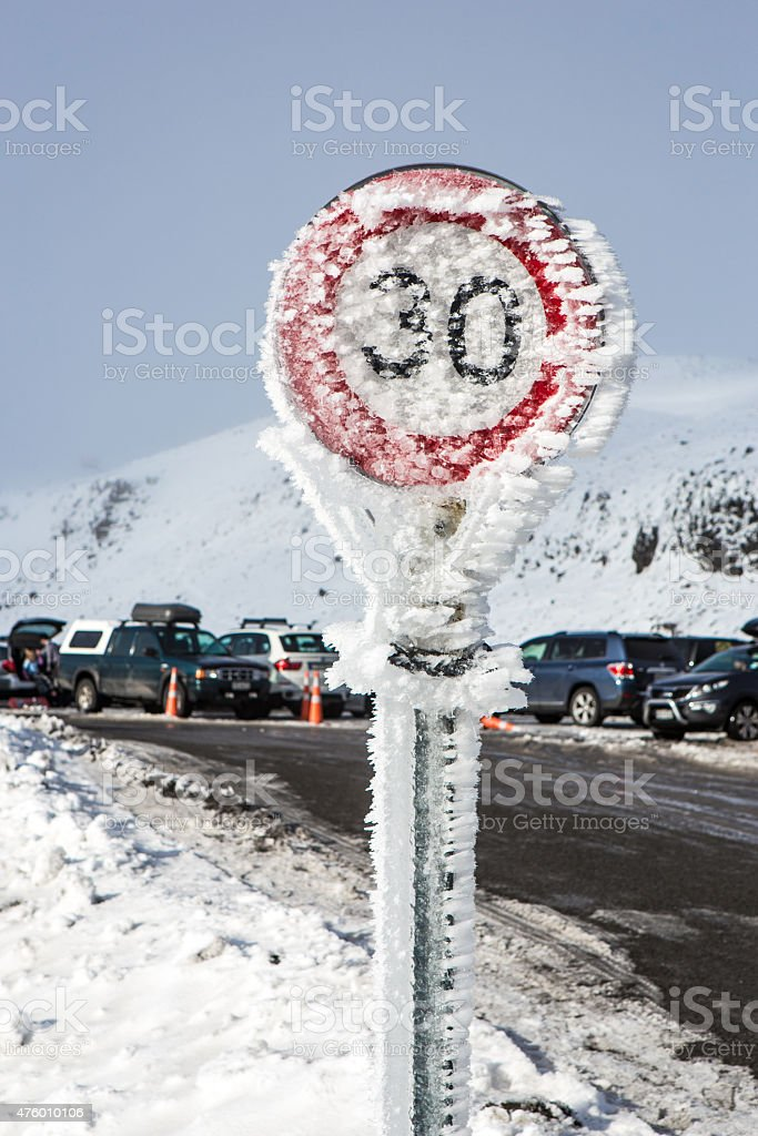 Ice-covered road sign on a mountain road stock photo