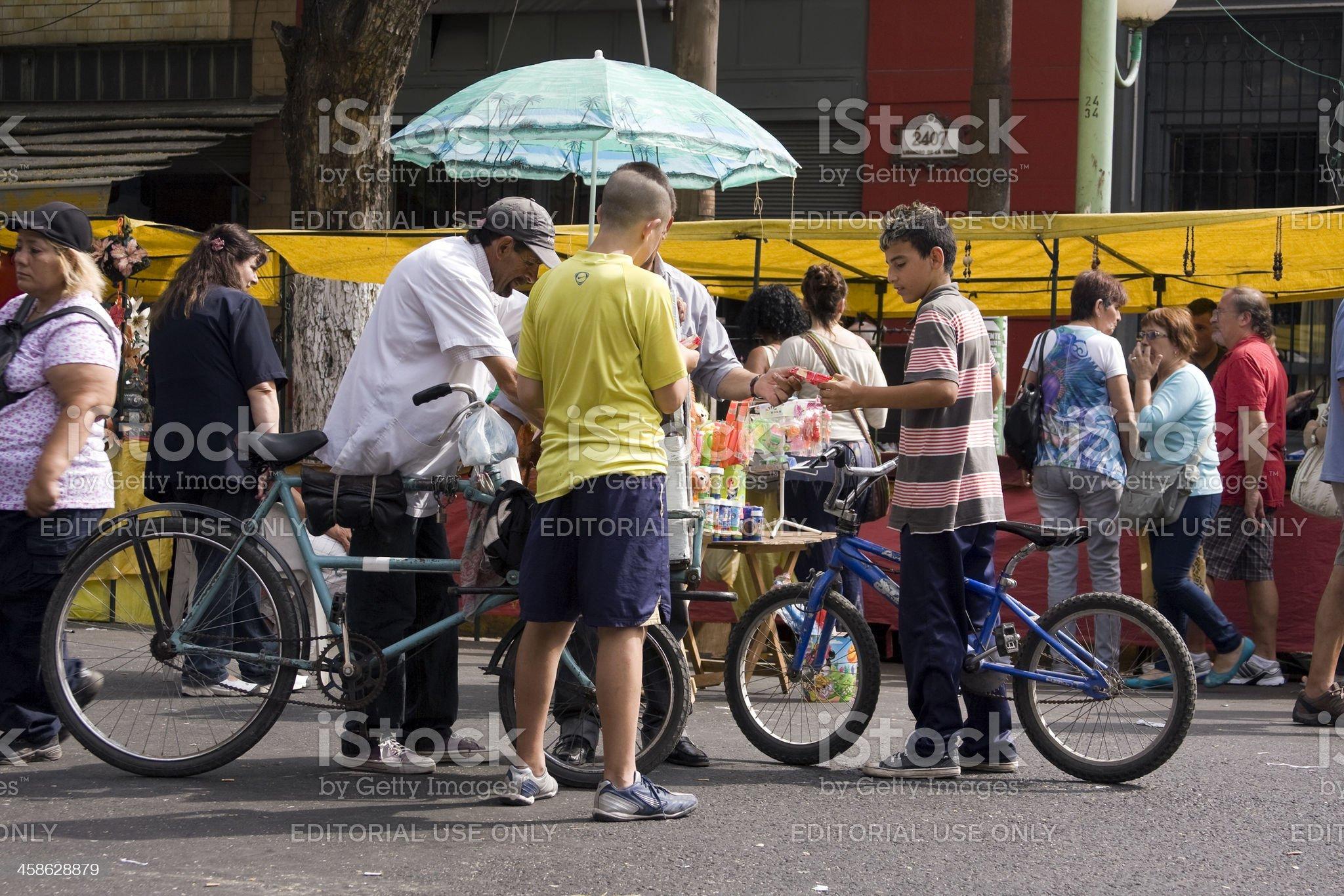 Ice-cream man in bike royalty-free stock photo