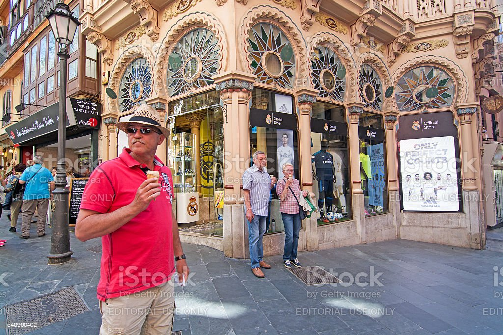 Icecream man in front of Can Corbella art nouveau building stock photo