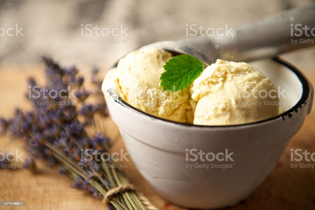 Ice-Cream Scoops in a Serving Dish with Lavender stock photo