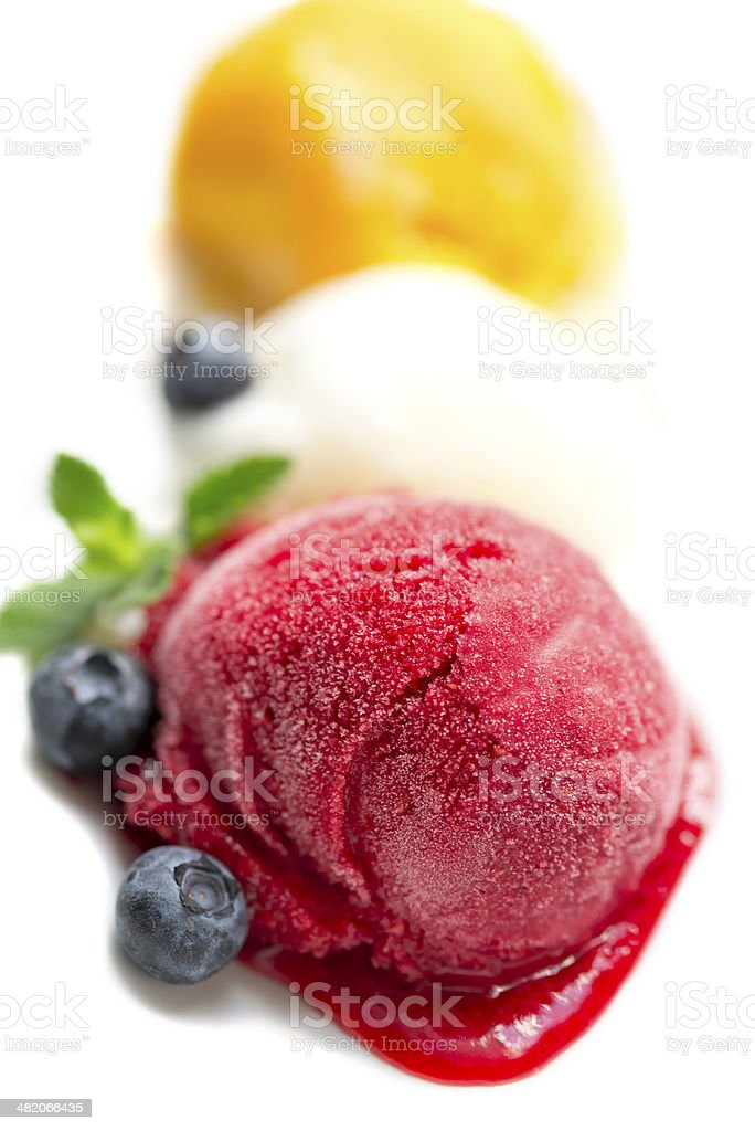 Ice-cream scoops with blueberry and mint leaf stock photo