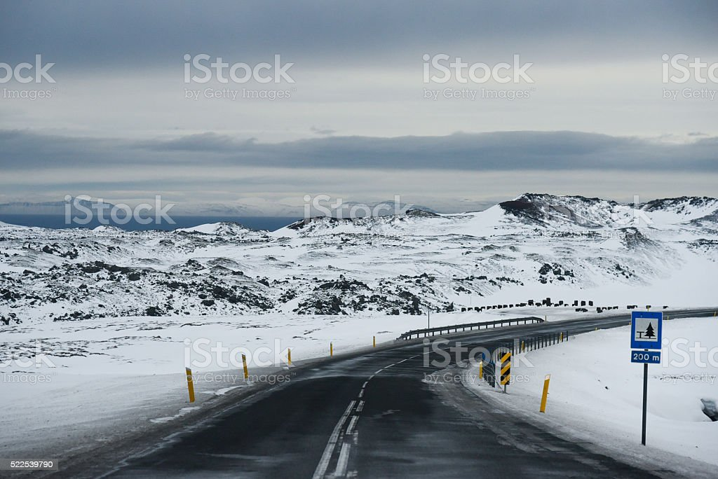 Iced and slippery road stock photo