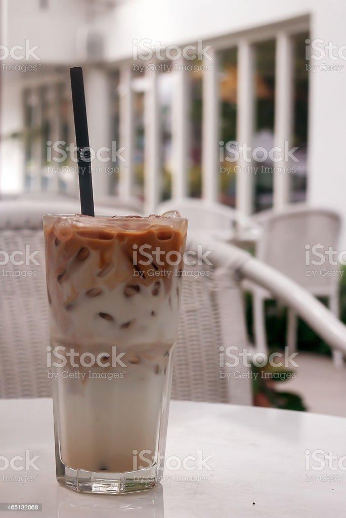 Iced Caramel Macchiato on the white table stock photo