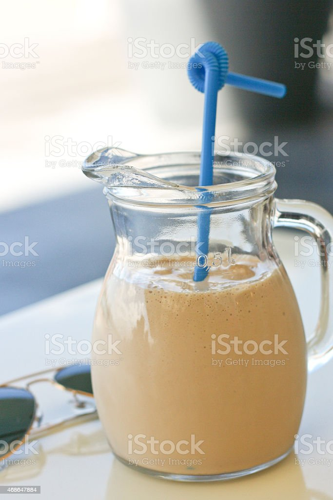 Iced coffee and sunglasses royalty-free stock photo
