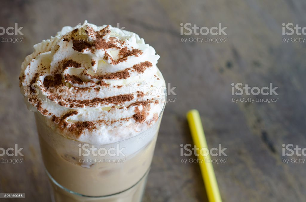 iced coffee in a glass on wood background stock photo