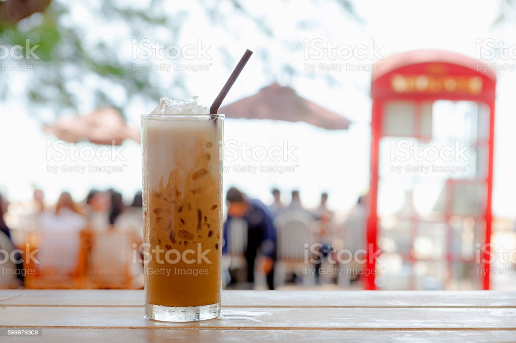 Iced coffee on a wooden table stock photo