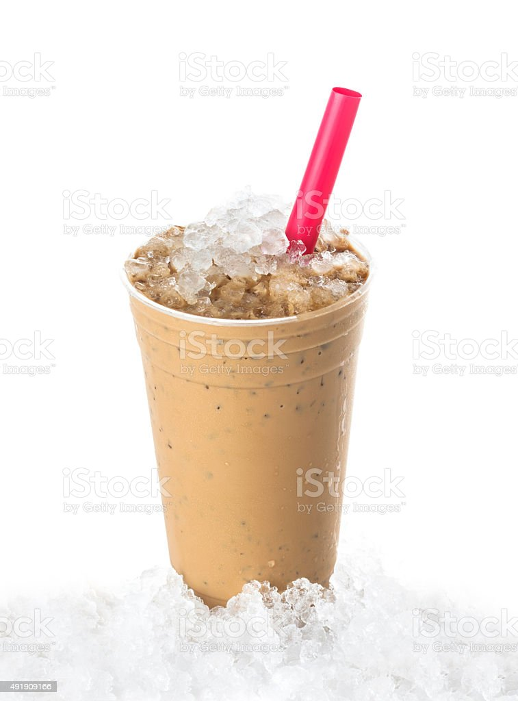 Iced coffee on ice with red straw stock photo