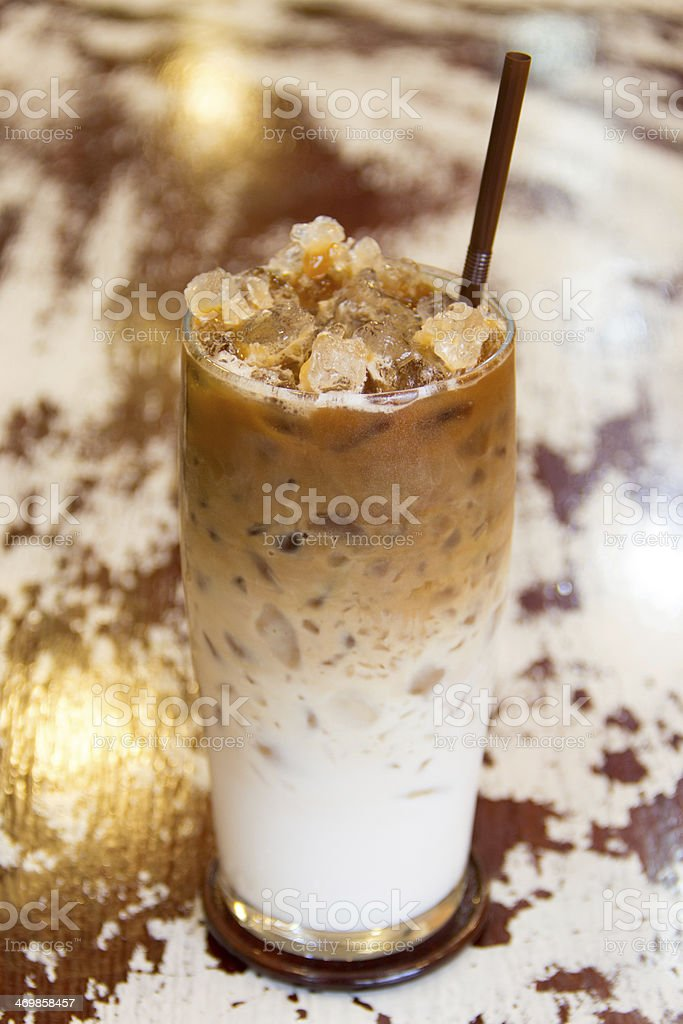 iced coffee on wooden scratched table stock photo