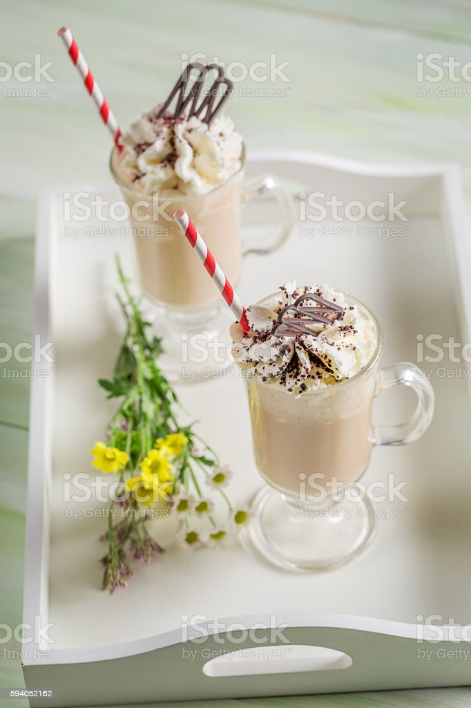 Iced coffee with whipped cream and chocolate stock photo