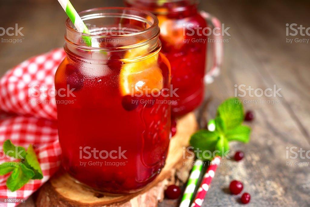 Iced cranberry tea with orange. stock photo