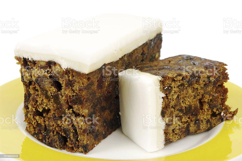 Iced Fruit Cake WIth Large Slice Cut royalty-free stock photo