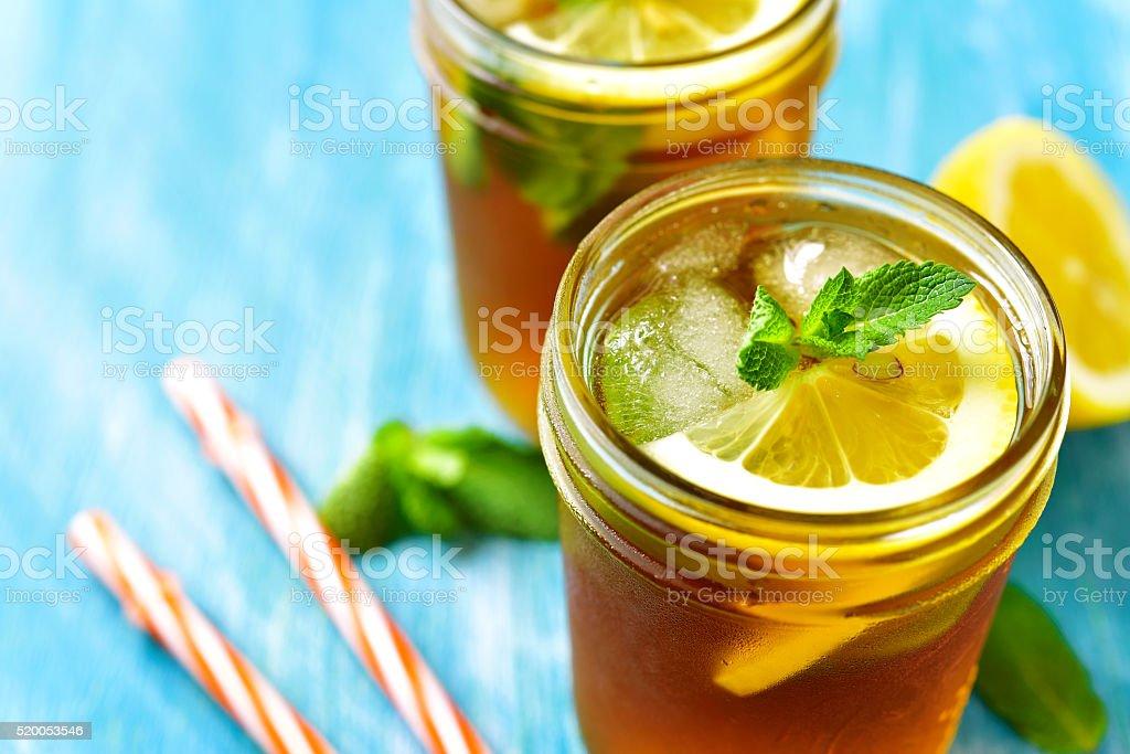 Iced lemon tea in a mason jar. stock photo