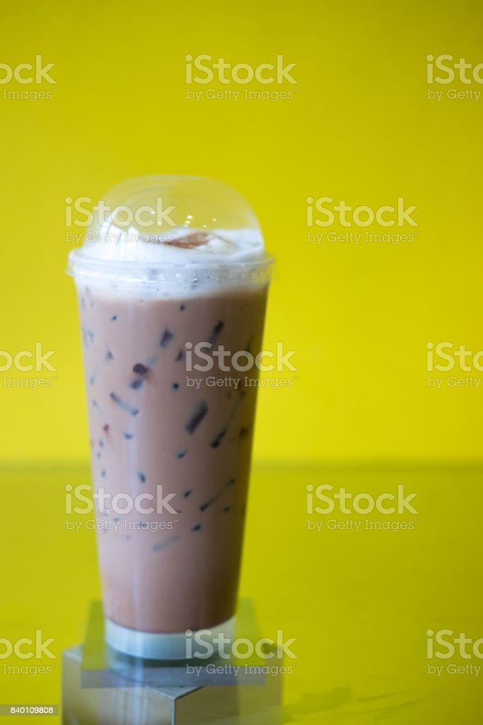 Iced Mocha Coffee in long glass on the glass table stock photo