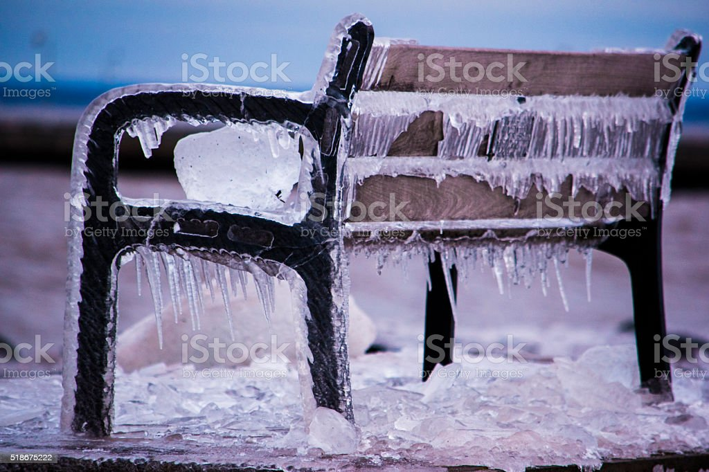 Iced over Park Bench stock photo