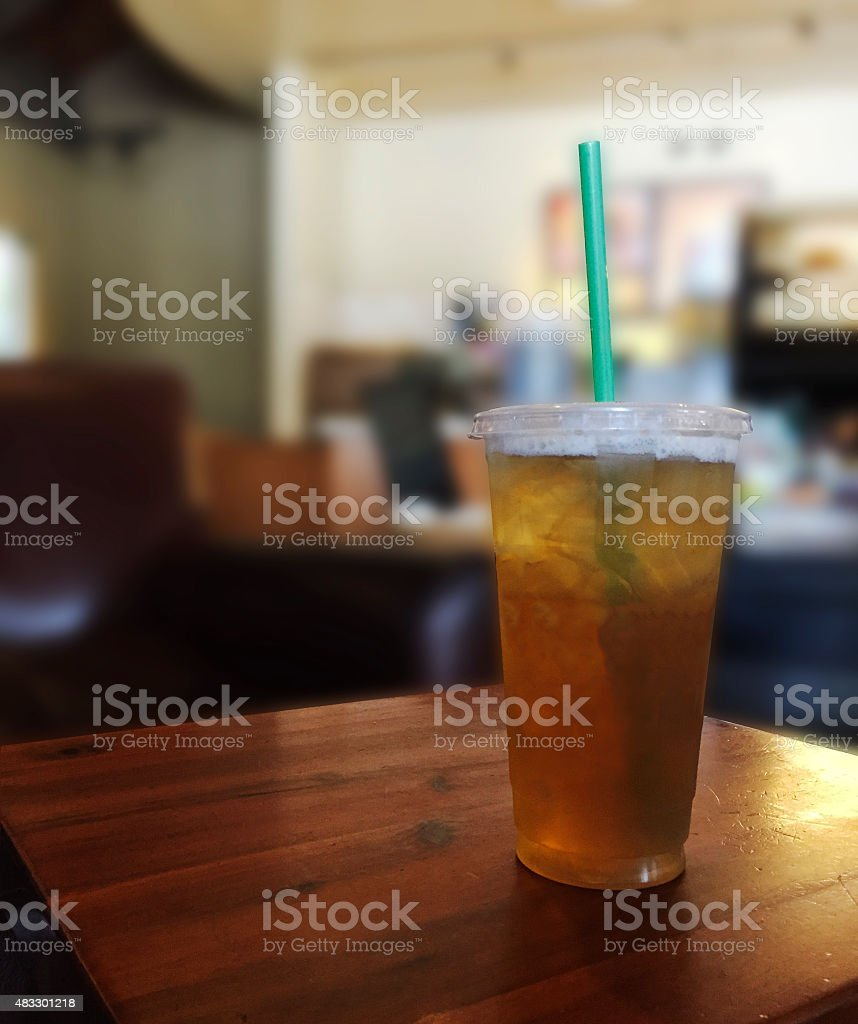 Iced Tea Drink on Wood Table in Coffee Shop stock photo