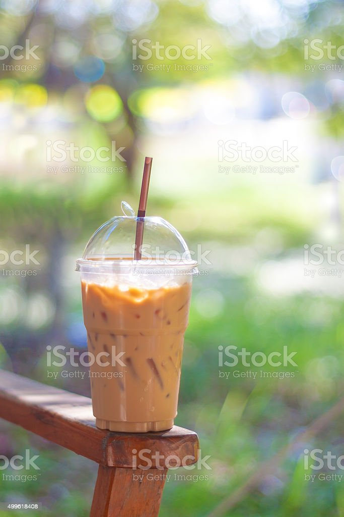Iced tea with milk  on wood table stock photo