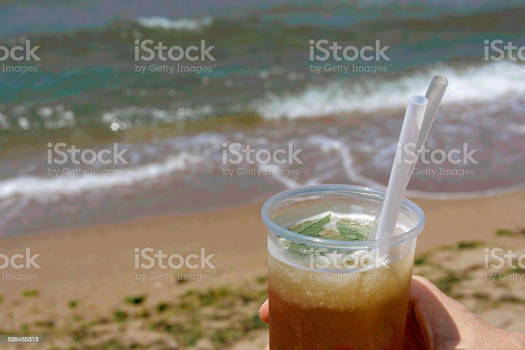 Iced Tea with Mint on the Beach stock photo