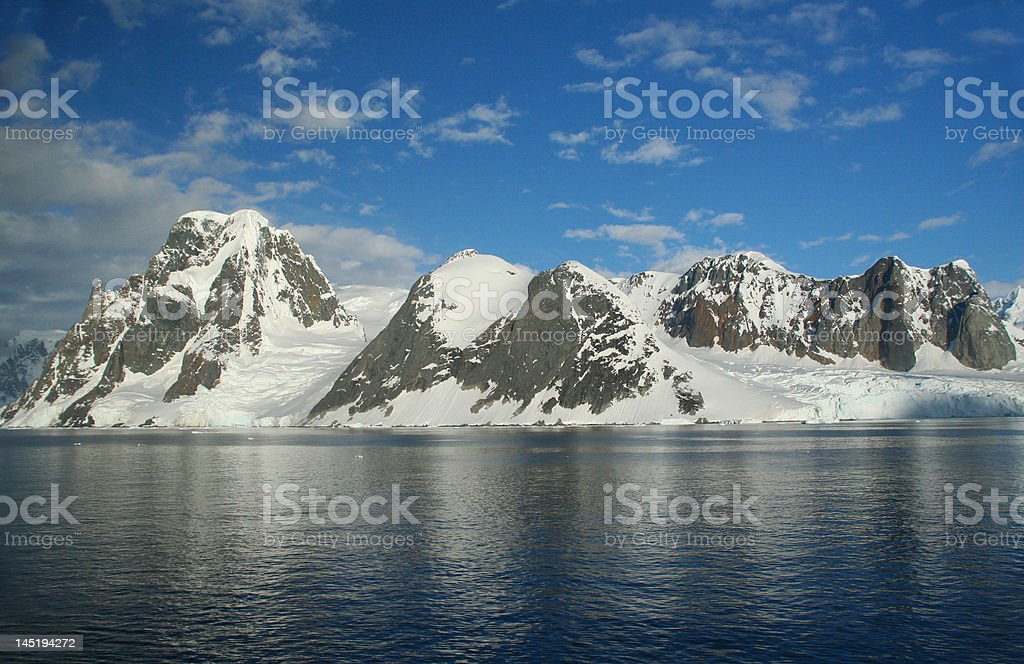 Icefall and glacier carved mountains stock photo