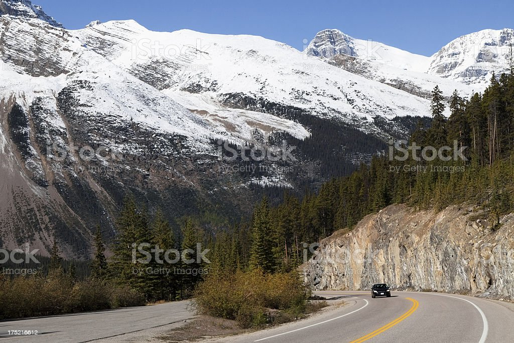 Icefield Parkway - car approaching through the mountain pass stock photo