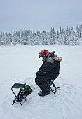Ice-fishing in Ruka in Lapland