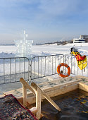 Ice-hole for bathing into cold water on Epiphany day. Russia