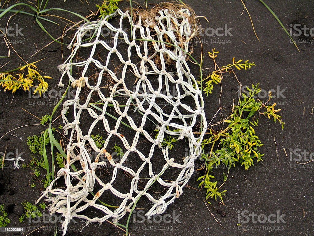 Iceland: Broken Fishing Net on Volcano Ash royalty-free stock photo