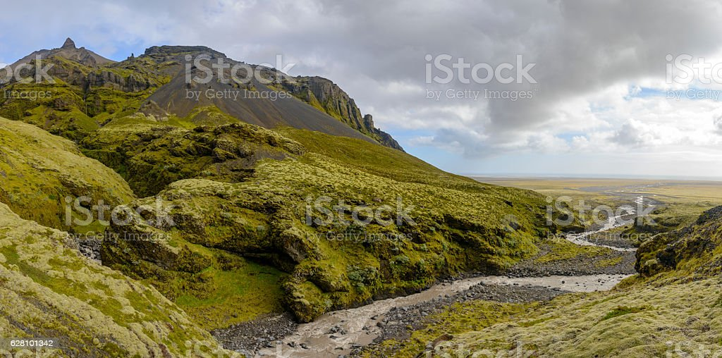 Iceland landscape with a river, grass and moss covered rocks stock photo