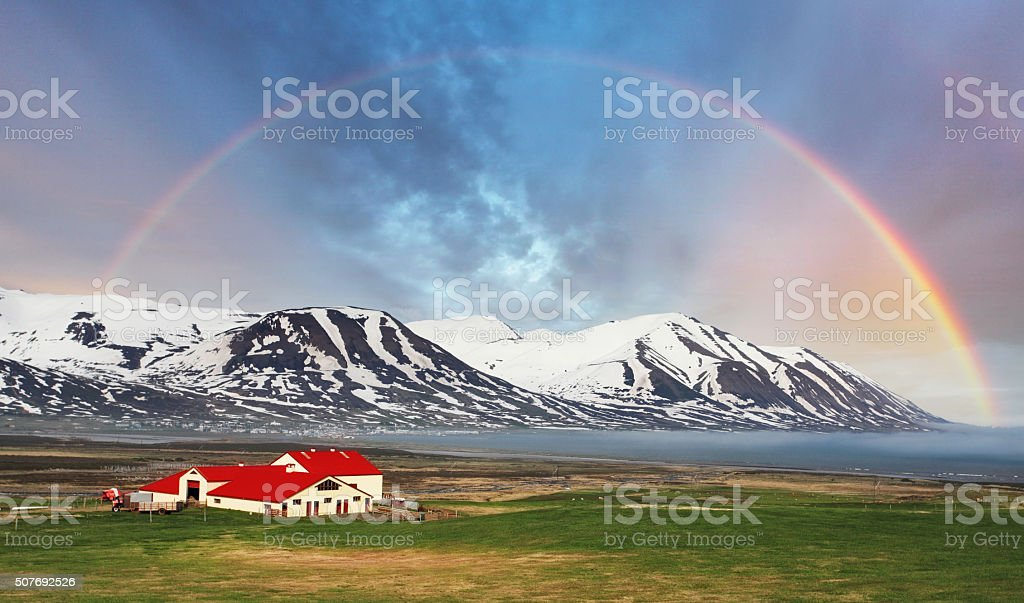 Iceland landspace mountain with rainbow stock photo