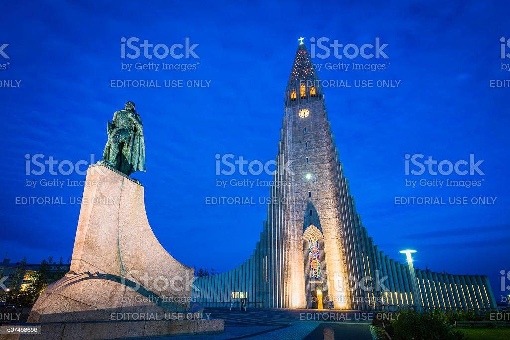 Iceland Leif Erikson statue illuminated in front of Reykjavik Hallgrimskirkja stock photo