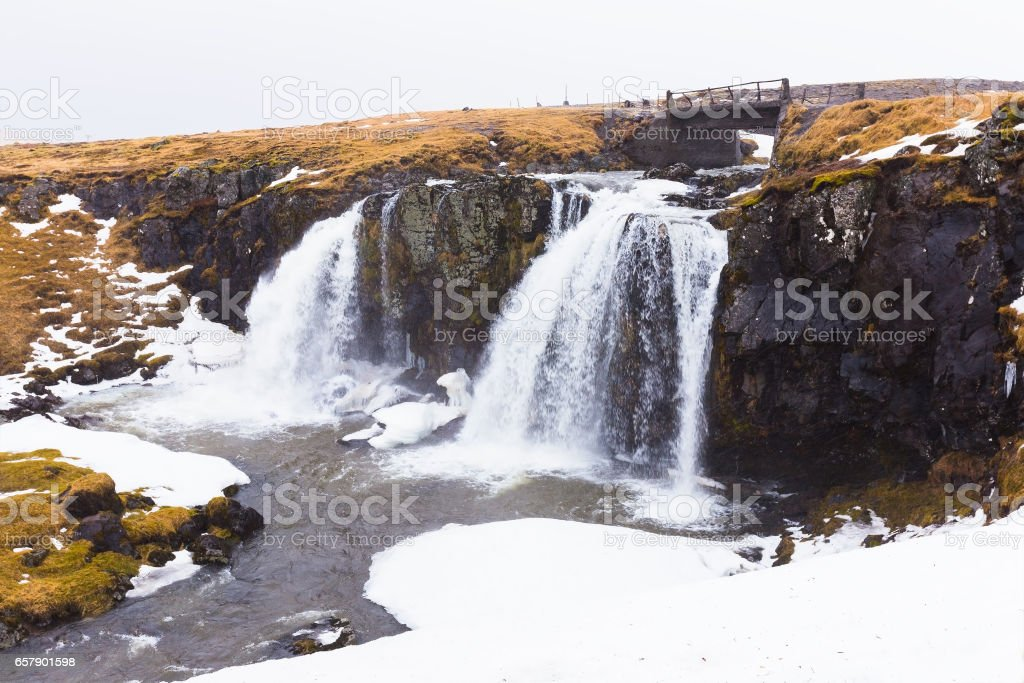 Iceland nature winter waterfall during late winter season stock photo