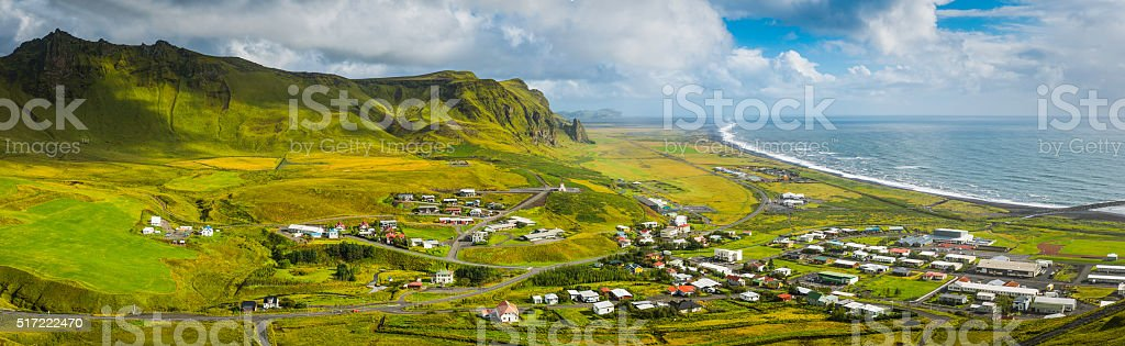 Iceland picturesque town of Vik between mountains and Arctic Ocean stock photo