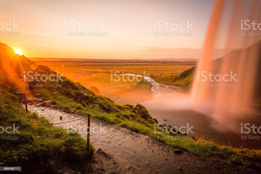 Iceland, sunset behind the fall, Seljalandsfoss stock photo